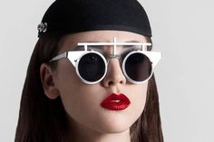 """Unisex round Goth Steampunk futuristic flip up sunglasses. the bottom is empty. a lens can by put. It have a cross design over the metal frame ,it is very different from other sunglasses. The metal flap lens are made of stainless steel and measure 43mm or 1 6/8 """" in diameter.   eBay!"""