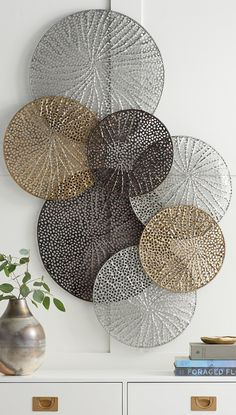 A stunning work that seems to float airily across your wall the Adele Metal Wall Art is formed of laser-cut metal disks welded together forming a striking display. Each disk has a lacy delicately textured cut-out design inspired by natural elements. Metal Wall Art Decor, Metal Tree Wall Art, Flower Wall Decor, Gold Metal Wall Art, Contemporary Wall Decor, Modern Wall Art, Silver Metal, Silver Glitter, Silver Wall Decor
