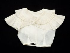 Made from white starched lawn. Handstitched. Dated 1825-1835. Snowshill Wade Costume Collection, National Trust Inventory # 1349953. Also on pages 50 and 51, object D, of Janet Arnold's 'Patterns of Fashion 1.'