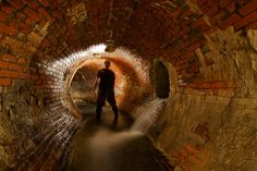 The spic and span brickwork around the the bend in the sewer.