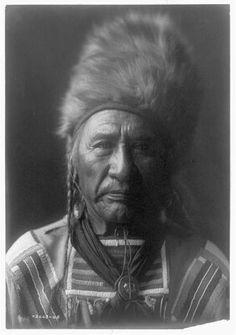 Old-Dog-Apsaroke-Crow-Indians-Native-Americans-fur-hat-bead-hide-Montana-c1908