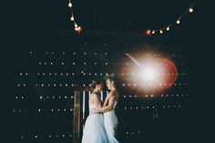 The setting sun sneaks through the Corn Crib's wooden slats as the newly wedded couple shares a quiet moment at the Historic Barns of Nipmoose. Lisa Woods Photography