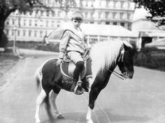 Archie Roosevelt, son of President Theodore Roosevelt, poses with Algonquin the calico pony June 17, 1902.