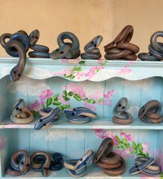Snakes on the dresser!  All handmade in polymer clay.  1/12 scale miniature. http://www.colnedollhouseshop.co.uk