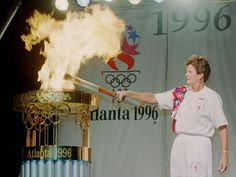 Former Olympian Pat Summitt lights the flame of the