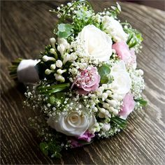 Roses, Bouvardia, Gypsophila, Bear Grass and Eucalyptus and were all colour themed in shades of baby pink, white and ivory.