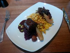 Venison roulade with a port jus and dark bitter chocolate, served with spaetzle, red cabbage, chestnuts, and pear @ Restaurant Krone