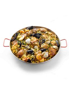 Paella -Perfect for a large dinner party, this paella serves 12, but the recipe can easily be doubled to feed a crowd. Pork tenderloin, calamari, shrimp, mussels, saffron, cognac