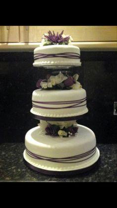 Purple ribbon cross wedding cake