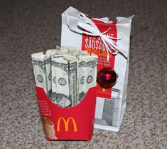 Another creative way to give the gift of CASH----bills are all folded up like fries and placed in the McD's bag!