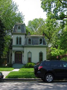 Little Second Empire Victorian House with a mansard roof