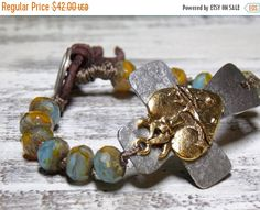 Beautiful Large Hammered Pewter Cross that has a Gold Sacred heart overlay and a single layer of gorgeous Czech beads. They are attached with a hand knot style.  Beautifull... ➡️ https://www.etsy.com/listing/168407097/sale-cross-bracelet-bohemian-knotted?utm_campaign=products&utm_content=95ebb2d1d9c34dd99c0835601961d196&utm_medium=pinterest&utm_source=sellertools