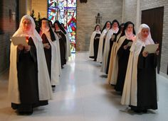 Discalced Carmelite Sisters Susanna Choi, left, and Mary Joseph Nguyen, who are novices, lead an Advent procession of the nuns at the Monastery of St. Joseph in Terre Haute in December. (Submitted photos/Carmel of Terre Haute)