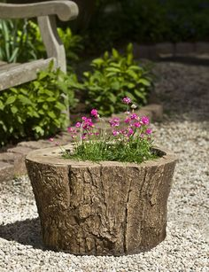 A wonderful way to keep your landscaping and gardening natural looking, the Adirondack Planter can be left empty, or filled wiht your favorite plants and flowers!