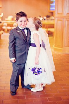 Doesn't get much cuter than this flower girl and the ring bearer. Photo by Shinano. #minneapolisweddingphotographers #flowergirl #ringbearer