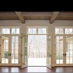 wall of french doors / windows ~ love the light they let in