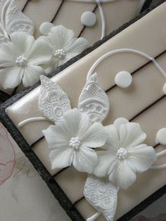 White Modeling Chocolate Flowers  by drakegore, via Flickr