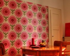 According to the Flickr post, this wallpaper was bought at www.johnny-tapete.de It's an original wallpaper made in the 70's.