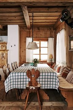 A plain check tablecloth and bench with cushions emphasises the informal Alpine feel.