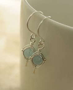 Pale blue aquamarine sterling silver earrings with herringbone wrapping. $26.00, via Etsy.