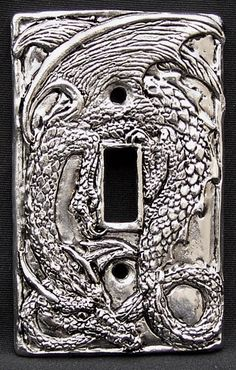 Dragon switchplate from Fellowship Foundry Pewtersmiths.  This could be really cute in a kid's room done in a children's story theme.