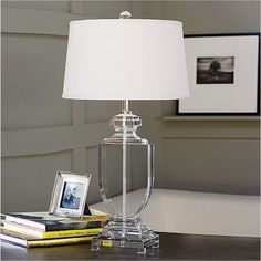 "Clean lines and a nod to a traditional urn make the Magnolia table lamp a versatile addition in any setting. Category: 16"" dia. Acrylic White"