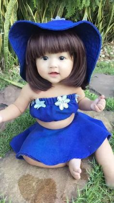 I had to study this closely to determine if it was a doll or a real baby girl!