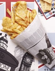 'Fish and Chips' of course (but only occasionally). Years ago they were served in a cornet of newspaper. Traditionally eaten with salt and malt vinegar. Yum!
