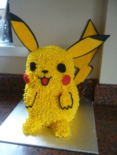 Pikachu - Pokemon made with the Wilton 3D teddy bear tin and adapted to make a Pikachu, the ears and tail were flooded icing however they...