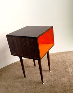 This would be one way to tie in the painting behind the sofa. This little beauty is a handmade Mid Century Modern styled Side Table finished in our homemade stain of Chocolate and Orange. Mid Century Modern Side Table, Mid Century Bed, Orange Furniture, Modular Cabinets, Side Tables, Mid-century Modern, Sofa, Homemade, Tie