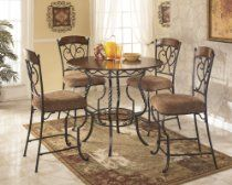 Nora 4pc Round Counter Height Table and Stool Set //  Description Softly curving decorative motifs lend the Nora brown wood dining set - Metal & fabric, a light and airy feel. These classic and casual pieces are the perfect choice for your dining room. Part of the Nora collection, this set includes a round dining table top and base, as well as a quartet of matching side chairs. Designed to sea// read more >>> http://Gussie635.iigogogo.tk/detail3.php?a=B00I3KOQ0Y