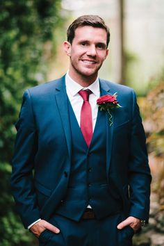 This navy suit works well with red for an autumnal wedding #weddingideas