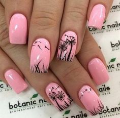 Glamorous nail art with dandelions outlined on the baby pink nails.