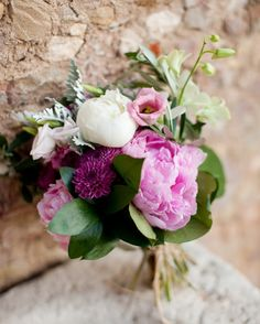 Peonies, olive branch, dendrobium orchids, pincushion dahlias, lisianthus, and dusty miller made up Nancy's bouquet.