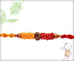 Fancy rakhi ----- Auspicious Rudraksh with Red-Yellow Beads Mauli Rakhi