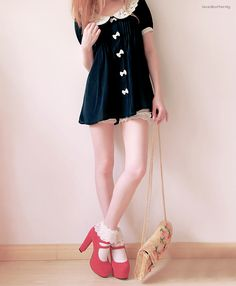 Cute, sweet gyaru: Black dress with white details and collar. Beige bag. White socks with frills. Pink shoes with heels.