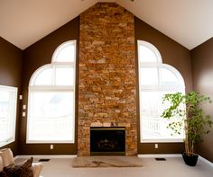 """""""Lick-and-Stick"""" stone won't break your budget.  You should see how this fireplace surround sparkles at night!"""