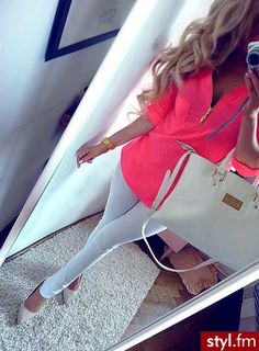 Neon pink top with white pants and nude shoes