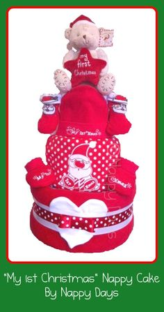 """My 1st Christmas"" Nappy Cake Contents: 3 tiers of Pampers Baby Dry Nappies (Size 3); 1 Luxury Fleece Blanket; 2 Cotton Muslin Squares; 1 Johnsons Baby Bathtime Product; 1 Bodysuit (0-3mths)' 1 ""My 1st Xmas"" Hat & Bootee Set (Newborn); 1 Pair Santa Socks (0-6mths); 1 ""My 1st Xmas"" Bib; 1 Pair Scratch Mitts (0-6mths); 1 Button Corner ""My 1st Christmas"" Teddy."