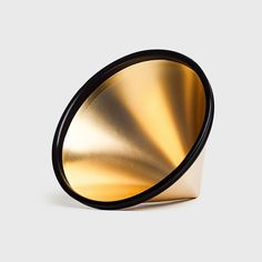 The GOLD KONE Coffee Filter is a stainless steel / 18k gold plated reusable filter which allows for more oils and a fuller bodied cup of coffee than paper. Designed to create the best coffee possible for those seeking a sustainable alternative to paper filter.
