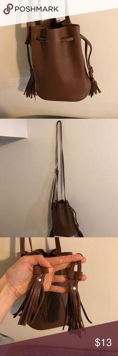 🎉HP🎉 H&M tan mini bucket tassel bag Dark tan/ used once/ adjustable shoulder strap/ two tassels as pulls on side Bags Mini Bags