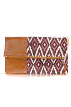 """This Joyn India foldover clutch is made of handwoven, hand spun, and handstamped cotton and features leather accents.  It has a fully lined interior with interior pocket.  Unfolded, its size is 9"""" x 9"""".  Folded, it is approzimately 4 1/2"""" x 9 inches.  Available in 2 beautiful prints.     Joyn Foldover Clutch by JOYN INDIA. Bags - Clutches Kentucky"""