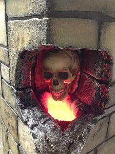 Rotating skull in wall/ column from Shingle Creek Manor .