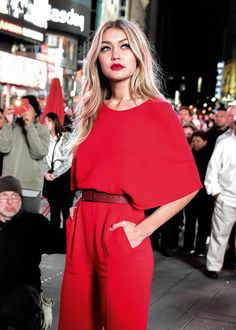 red jumpsuit, red lip, red belt, all of it.