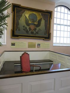 George Washington's pew at St. Paul's Chapel in New York City. After Washington's inauguration as the nation's first president in 1789, he walked to the chapel to pray. Above the pew is one of the earliest paintings of the Great Seal of the United States.