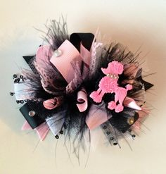 Pink and Black Poodle Funky Loopy  Hair Bow with Feathers   http://www.etsy.com/listing/121653126/pink-and-black-poodle-funky-loopy-hair?ref=sr_gallery_32_search_query=baby+girl+over+the+top_view_type=gallery_ship_to=US_page=49_search_type=all
