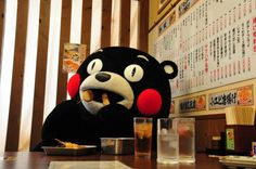 Kumamon(Mascot character of Kumamoto prefecture in Japan) is at Izakaya( Japanese pub restaurant).