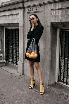 How to wear bright yellow socks with strappy sandals and all black Balenciaga 2017 sunglasses outfit matrix aesthetic conceptual editorial oranges in plastic bag Look Fashion, Daily Fashion, Fashion Outfits, Fashion Shoot, Unique Fashion, Fashion Bags, Fashion Design, Fashion Photography Inspiration, Photoshoot Inspiration