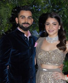 Indian cricketer Virat Kohli and his wife Bollywood actress Anushka Sharma pose during their wedding reception in Mumbai on December They were wed in Tuscany on December ending weeks of. Mens Wedding Wear Indian, Wedding Dresses Men Indian, Wedding Dress Men, Indian Bridal, Indian Dresses, Indian Wear, Indian Outfits, Bridal Dresses, Actress Anushka