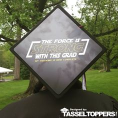 Info You have always felt special as if you had an unfair advantage over everyone else. Lets just say that the Force is Strong with you. Now you can let everyone in on your little secret...or your just a big Star Wars fan. About A Tassel Topper is the ultimate form of self expression and is the professional way to decorate your graduation cap. We print your design on a durable sheet of plastic that fits directly on top of your graduation cap with the help of our adhesives. The Tassel Topper…